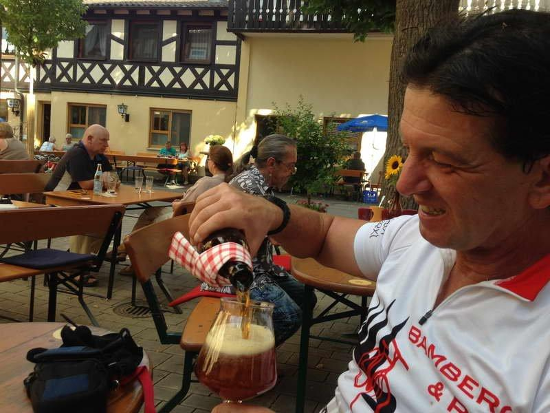 A cool beer after a tough ride for the mountainbike guide.